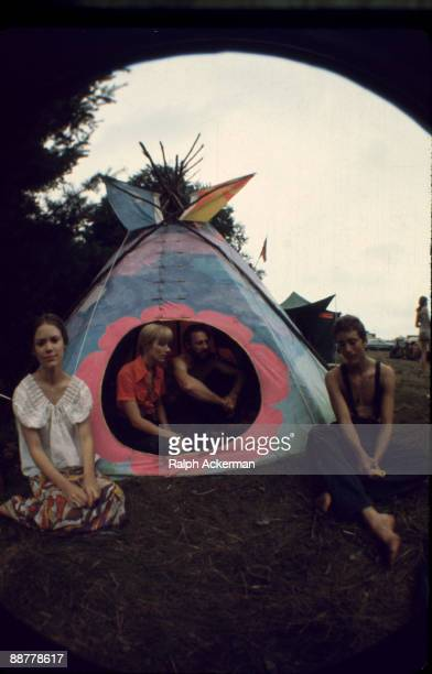 View of Woodstock Music Festival attendees sitting outside and within their tepee tent on the festival grounds Bethel NY August 1969
