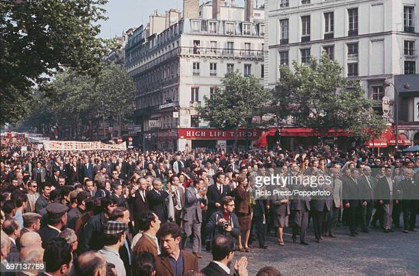 View of workers and trade union members affiliated to the CGT confederation of trade unions marching through the streets of Paris in a mass rally to...