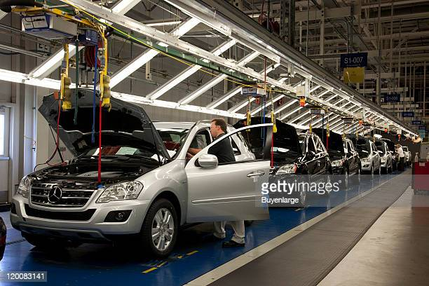 View of workers on the assembly line at the MercedesBenz US International assembly plant Tuscaloosa Alabama 2010