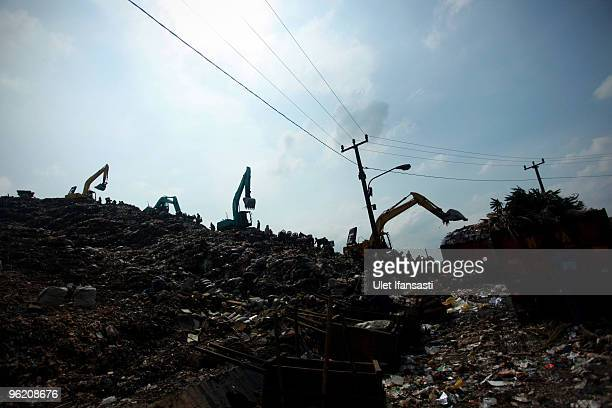 A view of workers on the mountain of rubbish alongside the excavators at the Bantar Gebang landfill site one of Jakarta's biggest dump sites on...