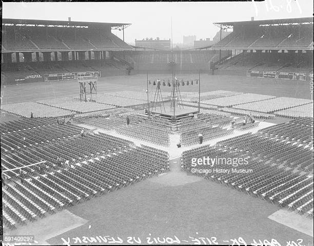 View of workers setting up the boxing ring and spectator seating at Comiskey Park for a match between King Levinsky and Joe Louis Chicago Illinois...