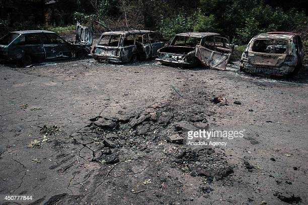 A view of wreckage of the cars following the clashes between the ProRussians separatists and Ukrainian Army in Lugansk Ukraine on June 17 2014 Four...