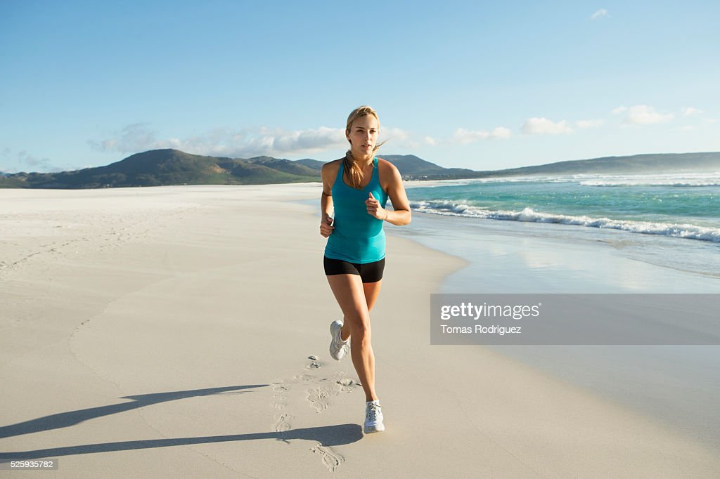 View of, young adult woman jogging : Stock Photo