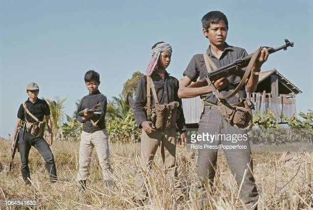 View of young armed Cambodian Army recruits preparing to enter the town of Tonle Bet near the Mekong River in Cambodia after it was recaptured from...
