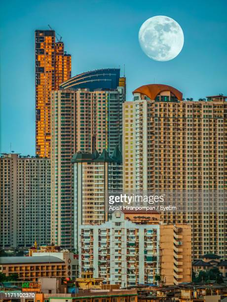 view off buildings against clear sky - apisit hiranpornpan stock pictures, royalty-free photos & images