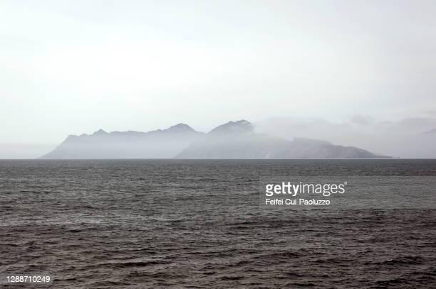view on a island of faeroe islands - seascape stock-fotos und bilder