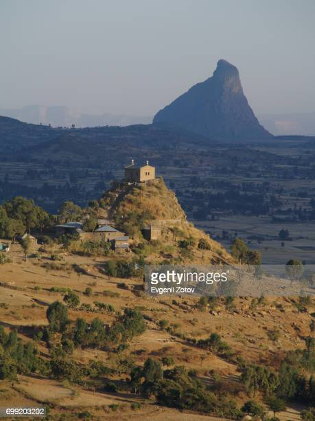 view on abba pentalewon church in vicinity of aksum city in ethiopia - axum stock photos and pictures