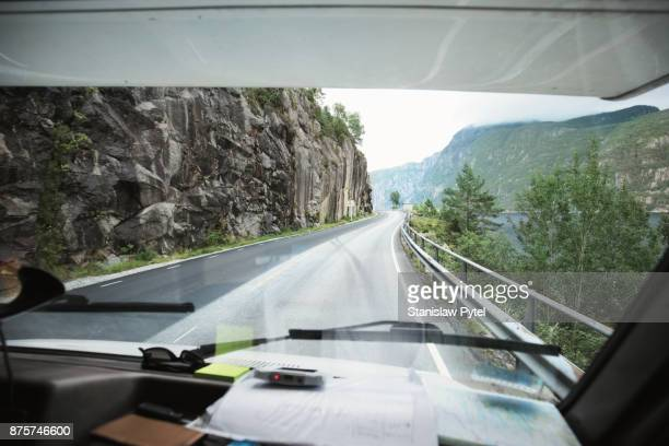 view on curvy road from cabin of campervan - vehicle interior stock pictures, royalty-free photos & images