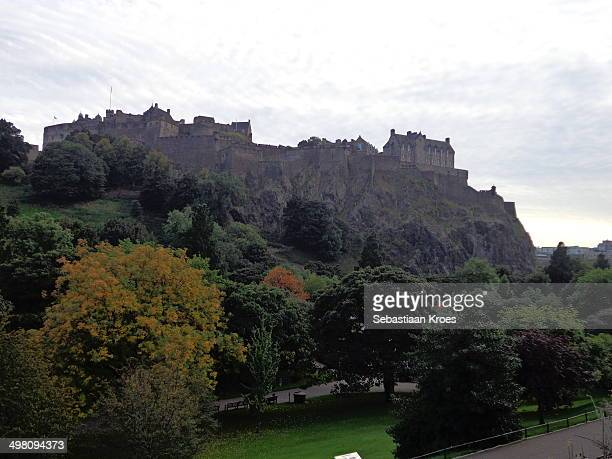 View on Edinburgh Castle during autumn, with many trees in autumn colours.