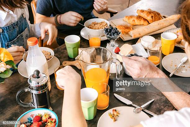 view on french family breakfast table - weekend activiteiten stockfoto's en -beelden