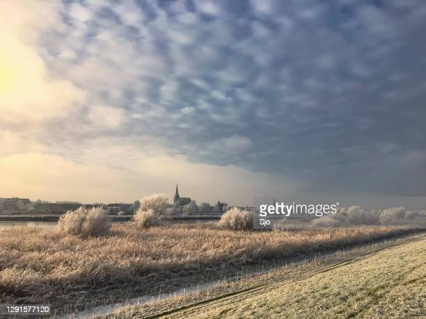 "view on kampen and river ijssel in winter in holland - ""sjoerd van der wal"" or ""sjo"" stock pictures, royalty-free photos & images"