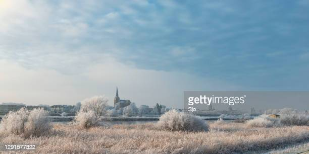 view on kampen and river ijssel in winter in holland - overijssel stock pictures, royalty-free photos & images