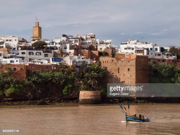 view on kasbah of the udayas over bou regreg river with a boat. rabat, morocco - rabat morocco stock pictures, royalty-free photos & images