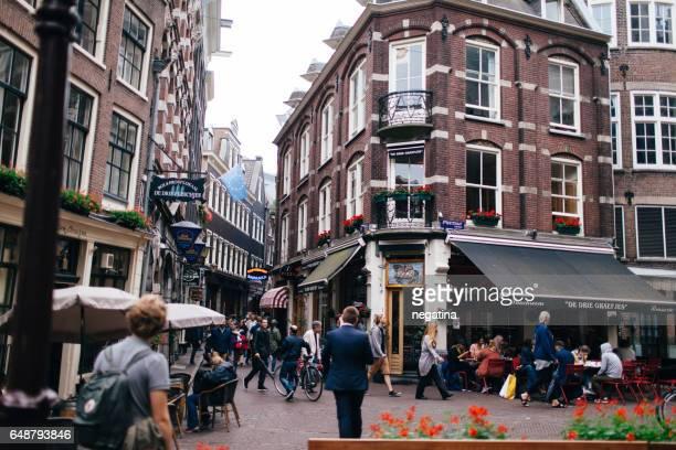 view on lunchroom de drie grafjes in amsterdam, netherlands - drie personen stock-fotos und bilder