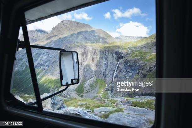 view on mountains from campervan - side view mirror stock photos and pictures