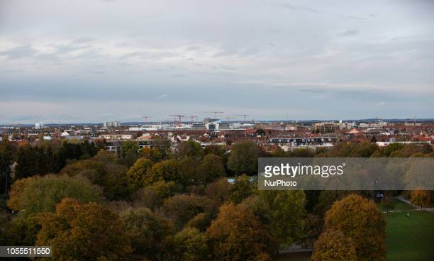View on Munich through som fall trees Impressions of the Fall in Munich on October 30 2018