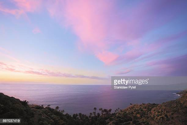view on ocean at sunset - colorful sunset stock photos and pictures