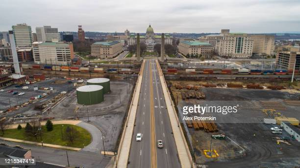 view on pennsylvania state capitol complex from state street. the city, which is usually busy during this time of weekday, is now deserted because of covid-19 novel coronavirus outbreak. - alex potemkin coronavirus stock pictures, royalty-free photos & images
