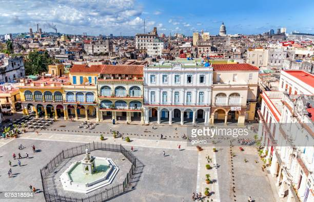view on plaza vieja of havanna with skyline and capitol - old havana stock pictures, royalty-free photos & images