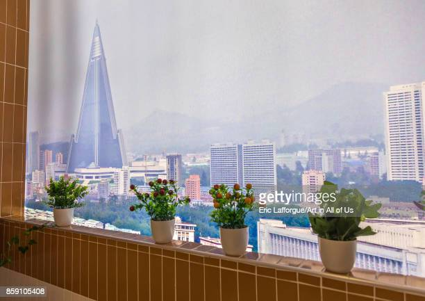 View on Ryugyong hotel from a balcony during the exhibition Pyongyang sallim at architecture biennale showing a north Korean apartment replica...