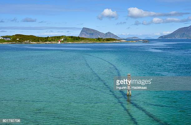 view on sea and mountains in sommarøy, county troms. turqouise water color. beautiful summer day up nort. - undersea stock photos and pictures