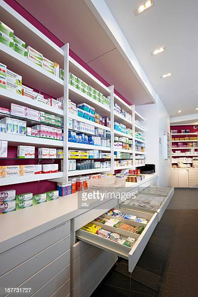 View on shelves and open drawers of a pharmacy