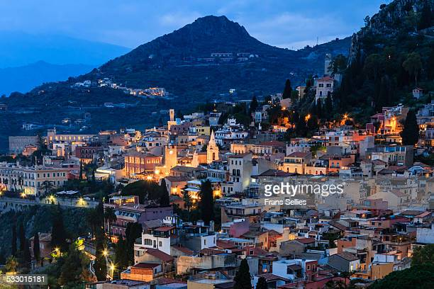 view on taormina (sicily) in the evening - taormina stock photos and pictures