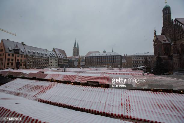 View on the Christmas Market and the Frauenkirche The worldfamous Christmas Market of Nuremberg was full of people even if there was heavy snowfall...