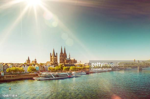 view on the cologne cathedral with rhine and a tourist boats - cologne stock pictures, royalty-free photos & images