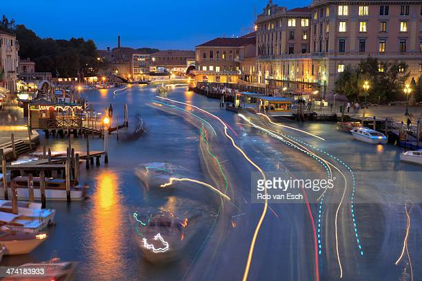 CONTENT] View on the Grand channel at night canal grande in Venice with the light trails of many boats due to long shutter speed The dotted blue...