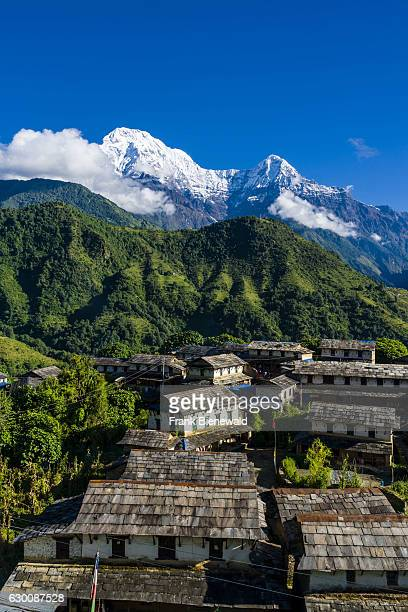 View on the historical village with the mountains Annapurna South , Himchuli in the distance.