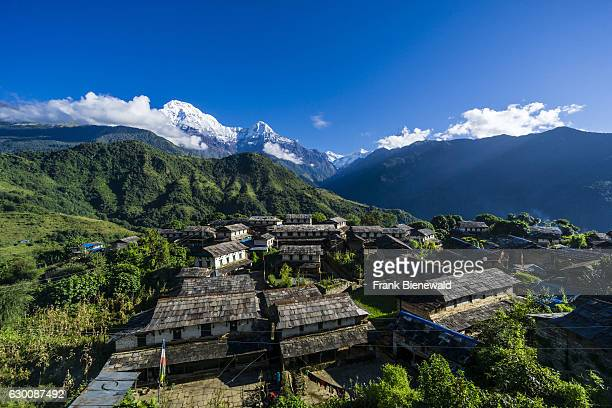 View on the historical village with the mountains Annapurna South , Himchuli and Machapuchare in the distance.