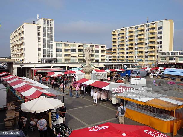 A view on the local tourist market in Noordwijk aan Zee with many different stands Holland statue