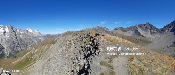 view on the mont blanc massif from a summit ridge in val ferret - 岩壁 ストックフォトと画像