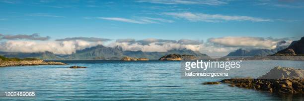 view on the norwegian coastline from the sea - rocky coastline stock pictures, royalty-free photos & images