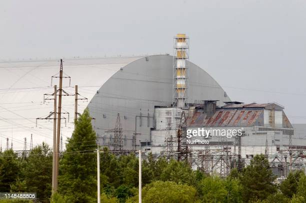 A view on the protective shelter over the remains of the nuclear reactor Unit 4 at the Chernobyl nuclear power plant during a press tour of the...