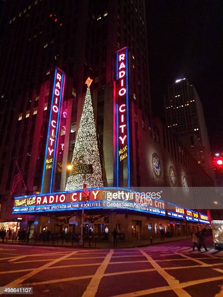 View on the Radio City Music Hall, in Christmas decorations and celebrating the 85th anniversary of the Rockettes. Evening, neon lights.