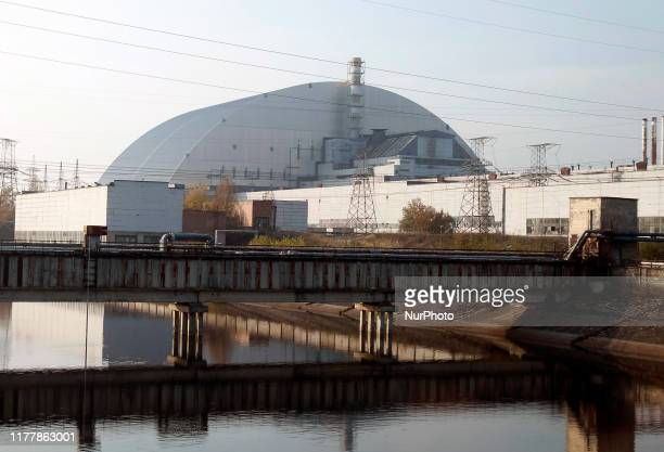 A view on the Safe Confinement over the 4th block of Chernobyl Nuclear power plant during a press tour to Chernobyl Exclusion Zone in Chernobyl...