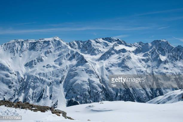 view on the snowy tiroler alps in austria during a beautiful winter day - solden stock pictures, royalty-free photos & images