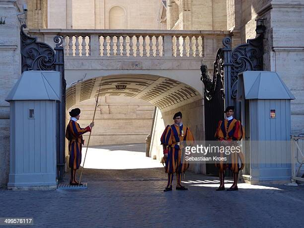 CONTENT] A view on the Swiss guards which guard the Vatican city in Rome / Vatican With colorful clothing on a sunny summer day