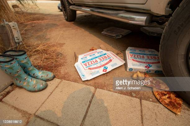 A view one of several pizza boxes containing pizza at the property where seven people were shot to death over Labor Day weekend at an illegal...
