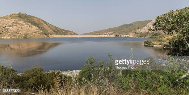 View onto a valley with a barrier lake and its dam on King Talal Dam on April 08 2016 in Amman Jordan