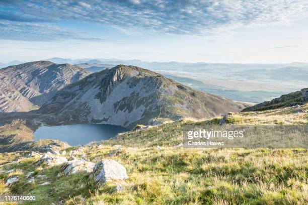 view onto llyn hywel from near y llethr;image taken from the cambrian way between the summit of y lethr, which is the highest point in the rhinog mountains, and cwm bychan. august - cambrian stock pictures, royalty-free photos & images