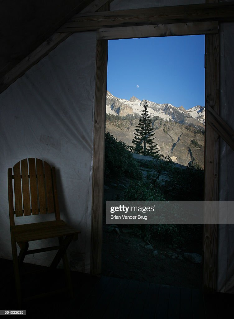 A view out the door of tent cabin 2 shows the moon rising over the peaks & A view out the door of tent cabin 2 shows the moon rising over the ...