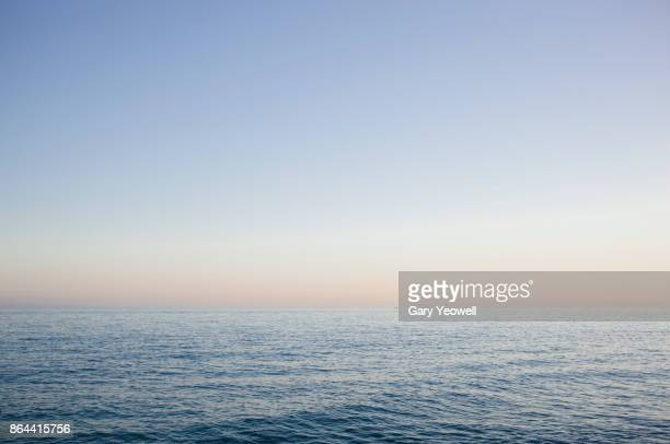 view out to sea from plaza balcon de europa in nerja - horizon stockfoto's en -beelden