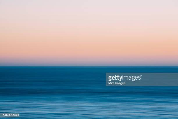 A view out to sea over the Pacific Ocean at dusk. Blurred motion.