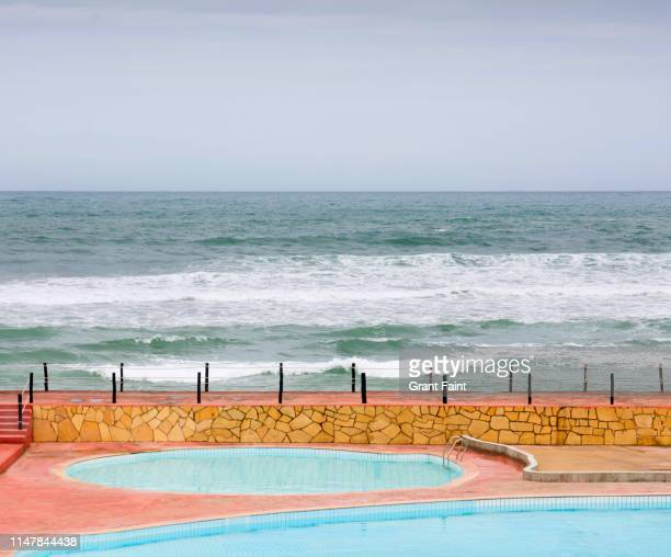 view out to sea with pools in foreground. - casablanca morocco stock pictures, royalty-free photos & images