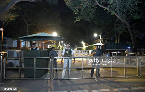 A view outside Congress President Sonia Gandhis residence with security personnel on alert after the removal of SPG security at Akbar Road on...