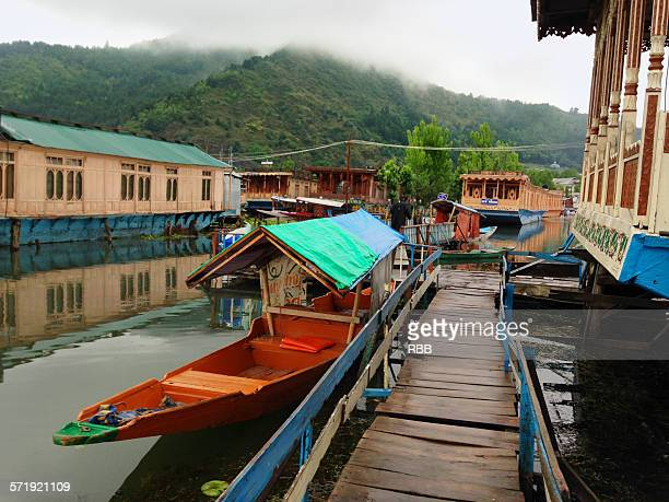 view outside house boat in dal lake - kashmir valley stock photos and pictures