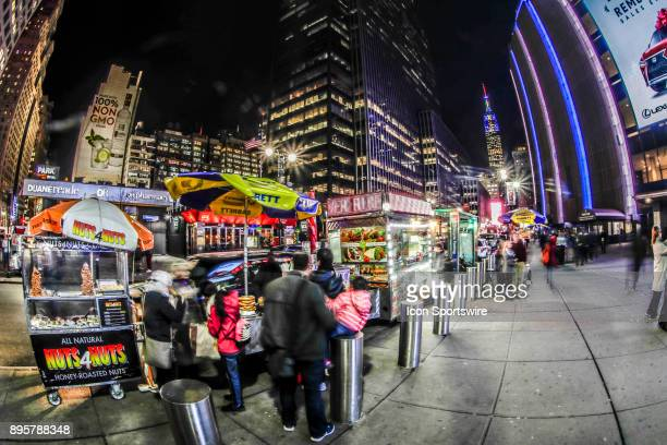 View outside Madison Square Garden with food trucks in foreground prior to the Anaheim Ducks and New York Rangers NHL game on December 19 at Madison...